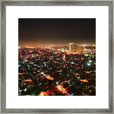 Jakarta At Night Framed Print by Simonlong