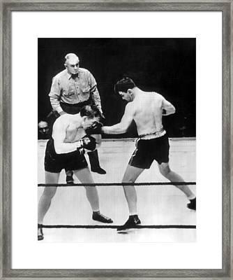 James Braddock Right Pummels Tommy Farr Framed Print by Everett