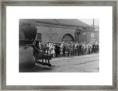 Japanese Americans At A Train Station Framed Print by Everett