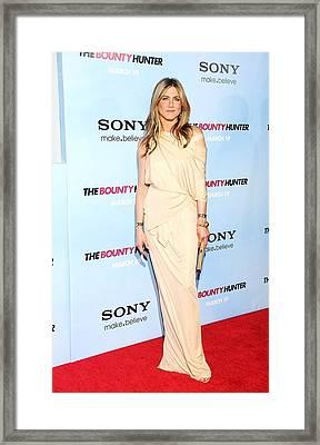 Jennifer Aniston Wearing A Donna Karan Framed Print