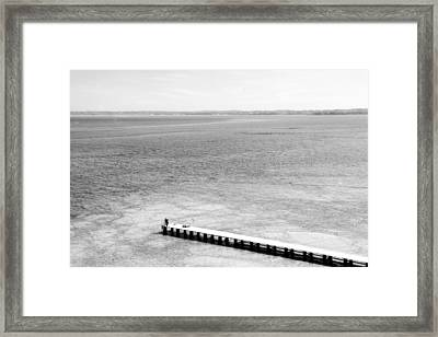 Jetty In A Lake Framed Print