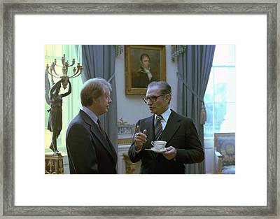 Jimmy Carter And The Shah Of Iran Talk Framed Print by Everett