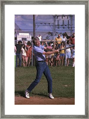 Jimmy Carter At Bat During A Softball Framed Print by Everett