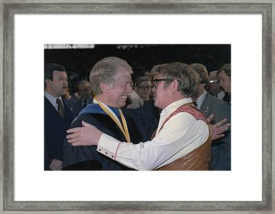 Jimmy Carter Greets His Brother Billy Framed Print by Everett