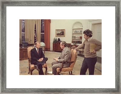 Jimmy Carter Prepares For An Interview Framed Print by Everett