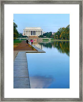 Jogging To The Memorial Framed Print by Steven Ainsworth
