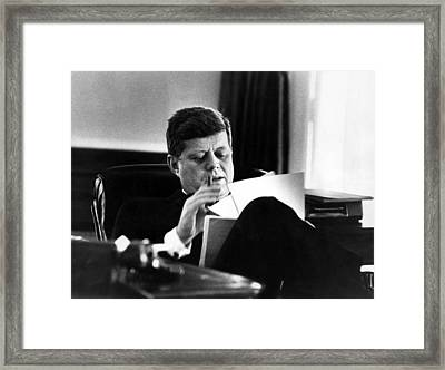 John F. Kennedy, In His Office Framed Print by Everett
