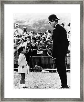 John F. Kennedy Jr. Looks Framed Print