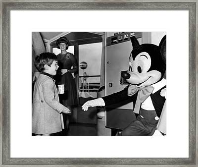 John F. Kennedy Jr. Reaches Framed Print