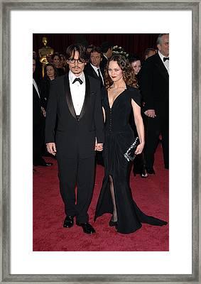 Johnny Depp,vanessa Paradis At Arrivals Framed Print by Everett