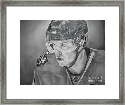 Jonathan Toews Framed Print by Brian Schuster
