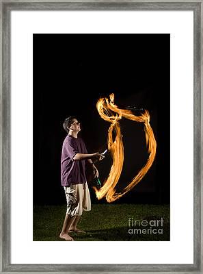 Juggling Fire Framed Print by Ted Kinsman