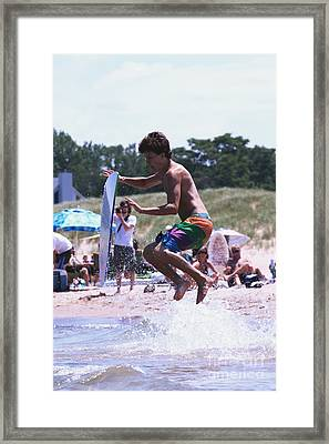 Jumping A Wave On A Skimboard Framed Print