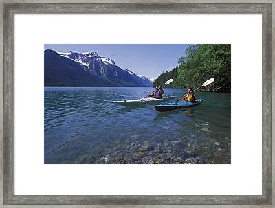 Kayaking On Chilkoot Lake Framed Print by Rich Reid