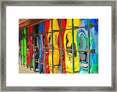 Kayaks In A Cage Framed Print by Susan Leggett