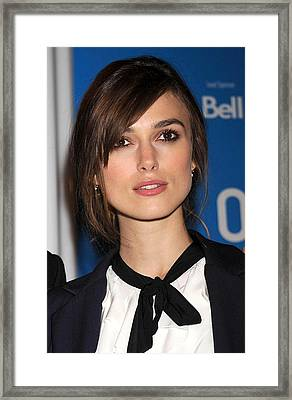 Keira Knightley At The Press Conference Framed Print