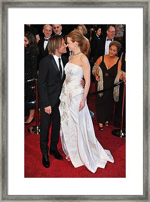 Keith Urban, Nicole Kidman At Arrivals Framed Print