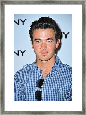 Kevin Jonas At Arrivals For Dkny Framed Print