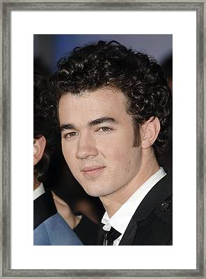 Kevin Jonas At Arrivals For Jonas Framed Print by Everett