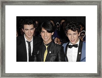 Kevin Jonas, Joe Jonas, Nick Jonas Framed Print by Everett