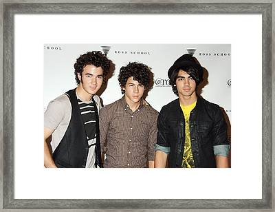 Kevin Jonas, Nick Jonas, Joe Jonas Framed Print by Everett