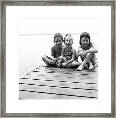 Kids Sitting On Dock Framed Print by Michelle Quance