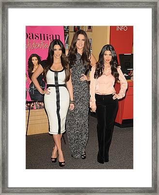 Kim Kardashian, Khloe Kardashian Framed Print