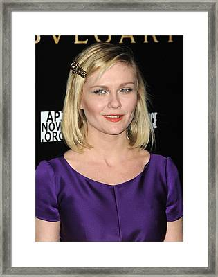 Kirsten Dunst At Arrivals For Bvlgari Framed Print by Everett