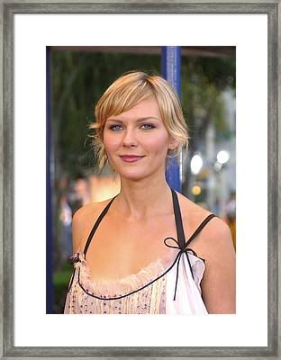 Kirsten Dunst At The Premiere Framed Print by Everett