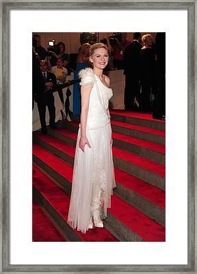Kirsten Dunst  Wearing A Dress Framed Print by Everett
