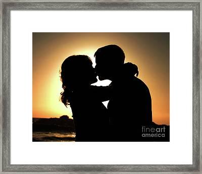 Kiss At Sunset Framed Print by Sabino Cruz