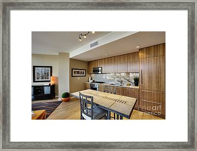Kitchen And Dining Area In Upscale Condo Framed Print