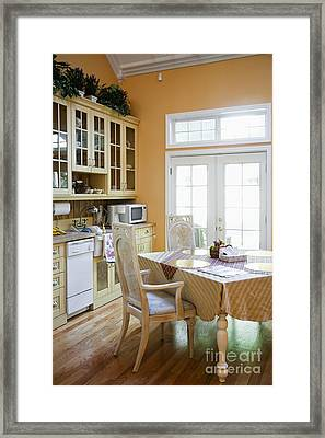 Kitchen Cabinets And Table Framed Print by Andersen Ross