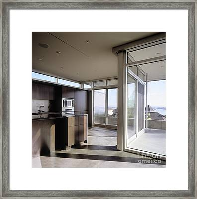 Kitchen With Glass Sliding Doors Framed Print by Robert Pisano