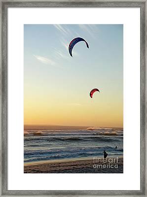 Kite Surfers On Beach At Sunset Framed Print by Sami Sarkis