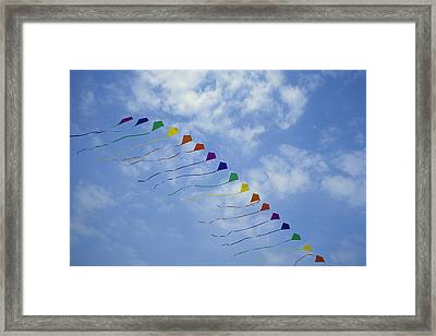 Kites Fly In A Rainbow Of Colors Framed Print by Stephen Alvarez