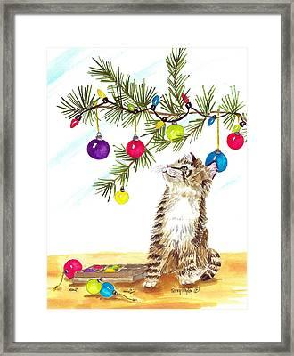 Kitten's First Christmas Framed Print