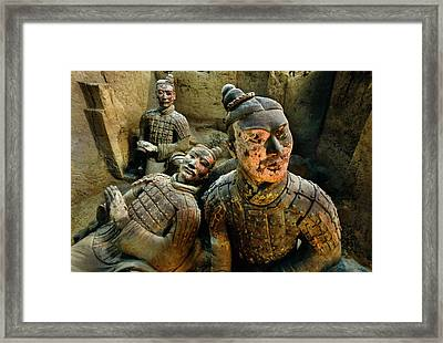 Kneeling Archers Rise From The Earth Framed Print