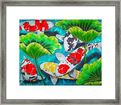 Koi And Lotus Framed Print by Daniel Jean-Baptiste