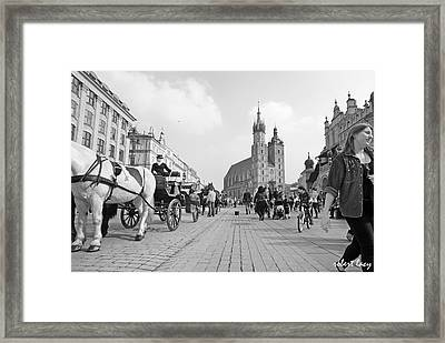 Krakow Carriages Framed Print by Robert Lacy