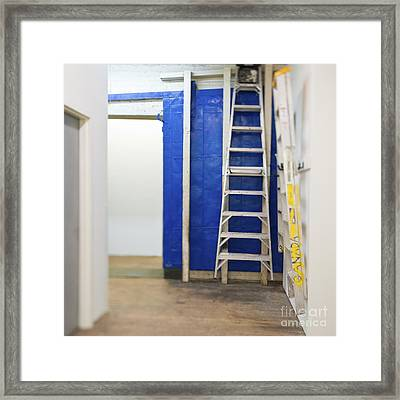 Ladders On The Wall Framed Print