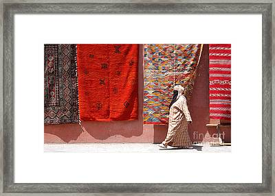 Lady And The Carpets Framed Print by Steve Goldstrom