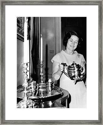 Lady Bird Johnson Holds A Silver Teapot Framed Print by Everett
