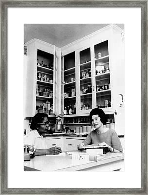 Lady Bird Johnson, In The Kitchen Framed Print by Everett