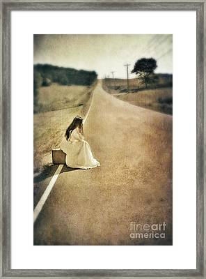 Lady In Gown Sitting By Road On Suitcase Framed Print by Jill Battaglia