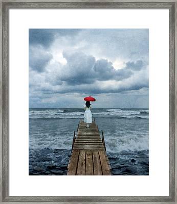 Lady On Dock In Storm Framed Print by Jill Battaglia