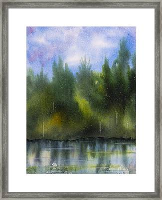 Lake Reflecting Trees Framed Print by Debbie Homewood