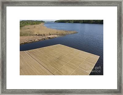 Lakeside Dock Framed Print by Jaak Nilson