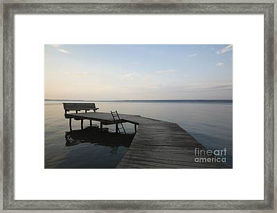 Lakeside Dock With Bench At Dusk Framed Print by Roberto Westbrook