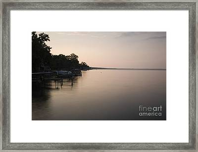 Lakeside Dock With Boat At Dusk Framed Print by Roberto Westbrook